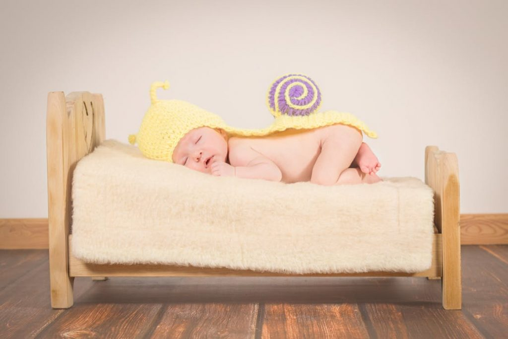 Baby sleeping on a bed