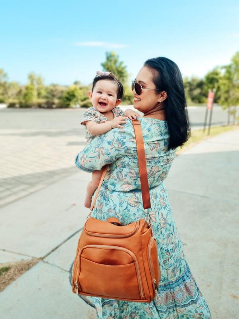 Mom with her baby and nappy bag