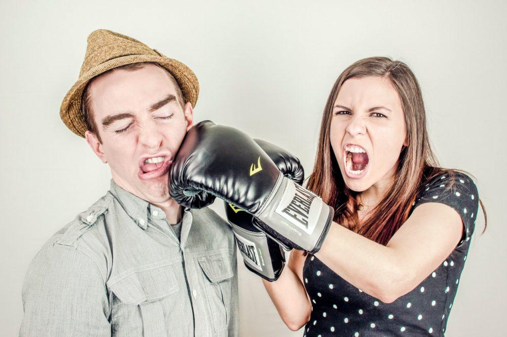 Woman punching man's face